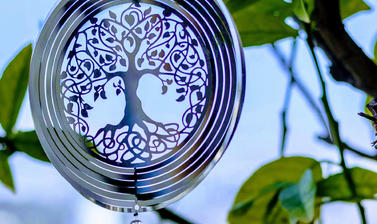 Chakra meditation, ornament hanging from tree photo by Lavi perchik unsplash